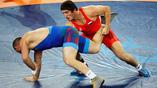 Российский борец-вольник Абдулрашид Садулаев (справа) вышел в финал Олимпийских игр