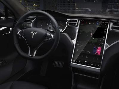 """Tesla и AMD разработают собственный чип для """"умных"""" машин"""
