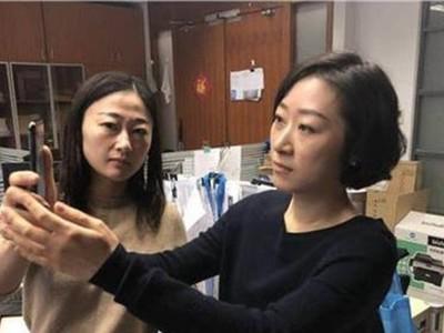 Китаянка разблокировала iPhone X лицом коллеги
