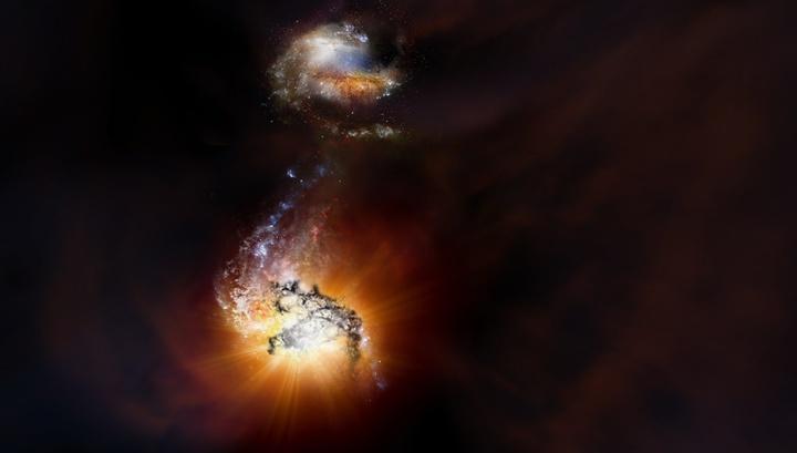 Две гигантские галактики ранней Вселенной запечатлены в процессе слияния