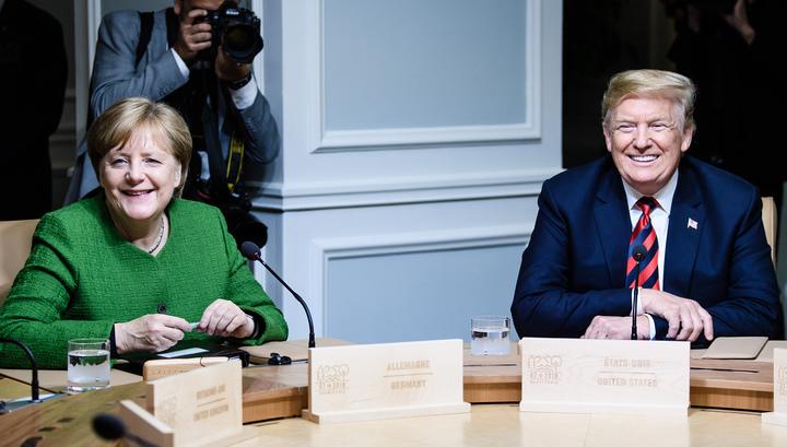 Зачем Трамп бросил Меркель две конфетки