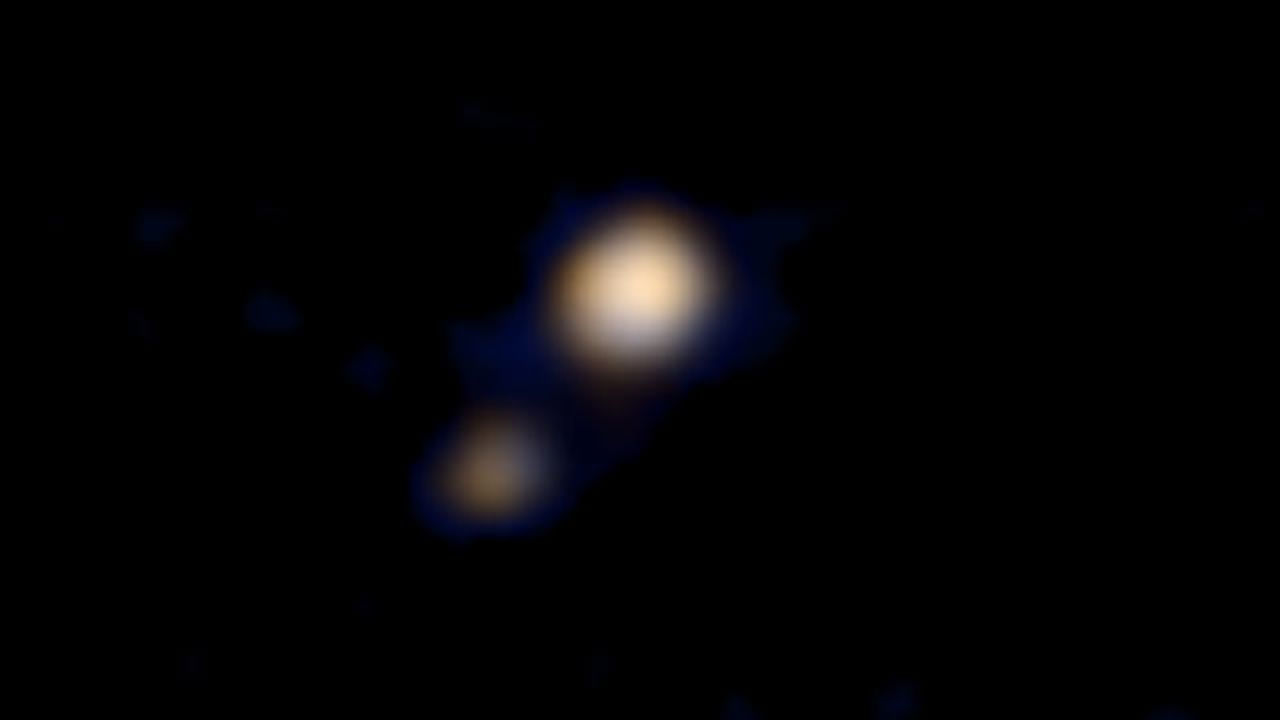 Зонд New Horizons прислал первый цветной снимок Плутона и Харона