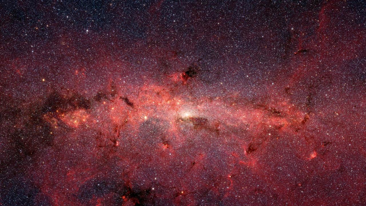 Гамма-лучи из центра Галактики могут быть сигналом от тёмной материи