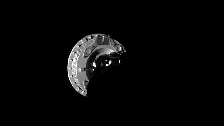 Фотография пробоотборника системы TAGSAM, сделанная бортовой камерой зонда.