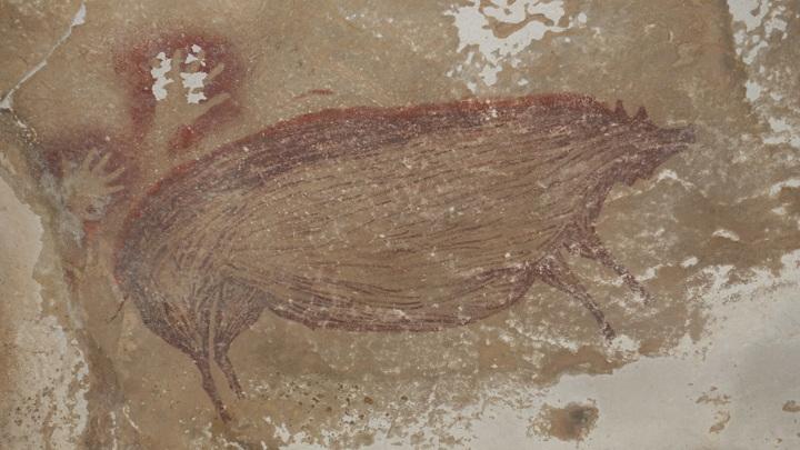 Археологи обнаружили самый древний наскальный рисунок в мире.